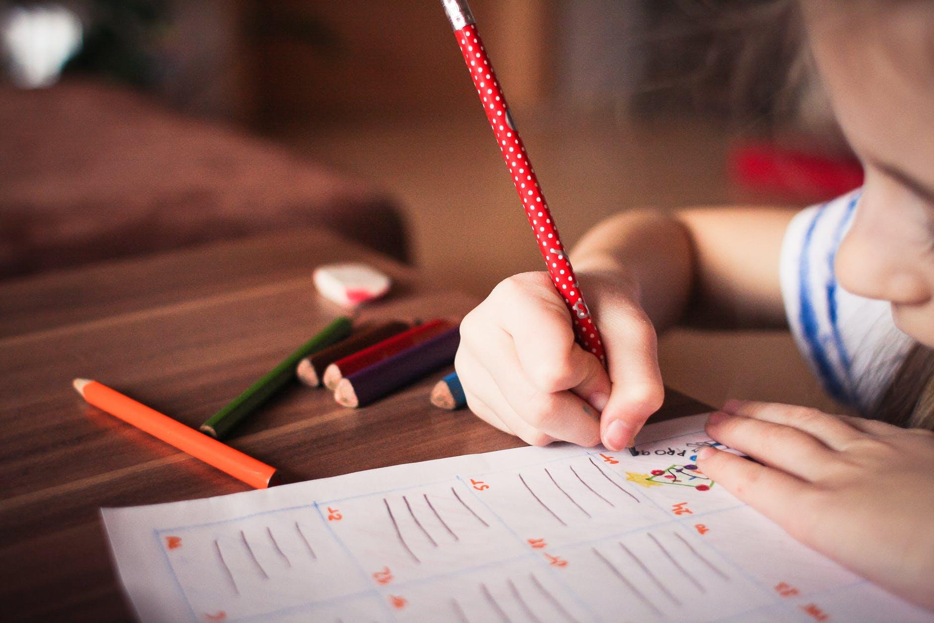 close up of girl writing