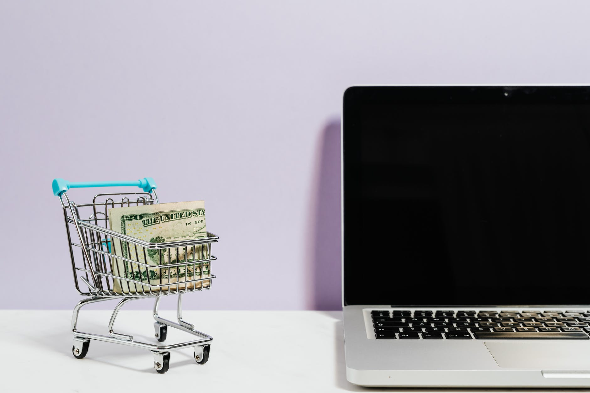 shopping cart next to a laptop